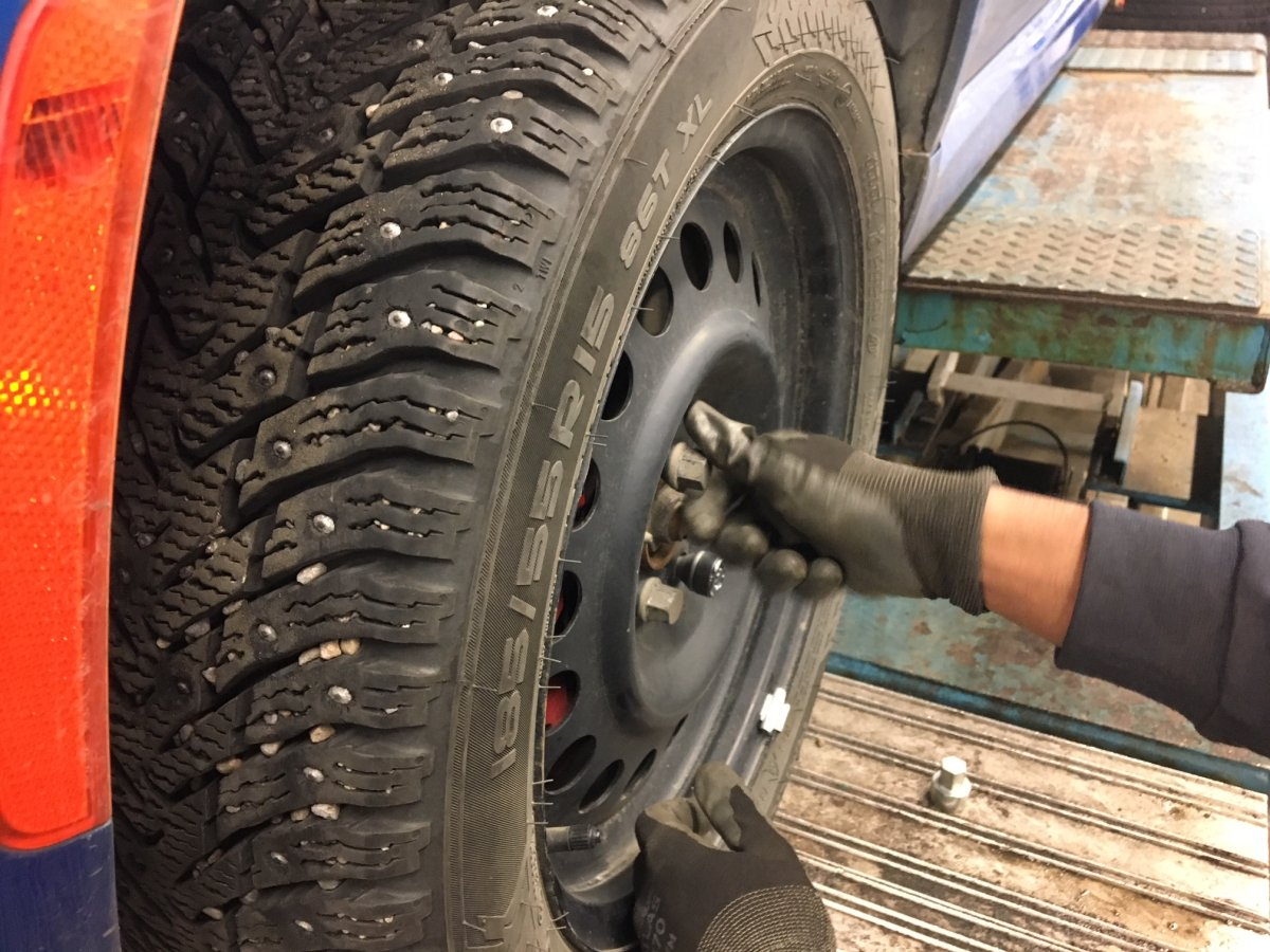 A winter tire being installed on a car at a Kal Tire shop in Edmonton, Alta. November 1, 2017.