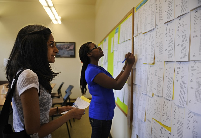 Zohra Surani, 21, left and Melinda Cuffy, 23, pour over job listings at the Summer Jobs Services Centre at 511 Richmond Street West in downtown Toronto.