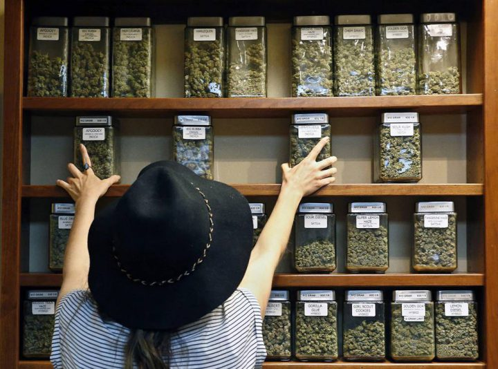 A store worker arranges jars of marijuana at a store in Boulder, Colo. in this file image.