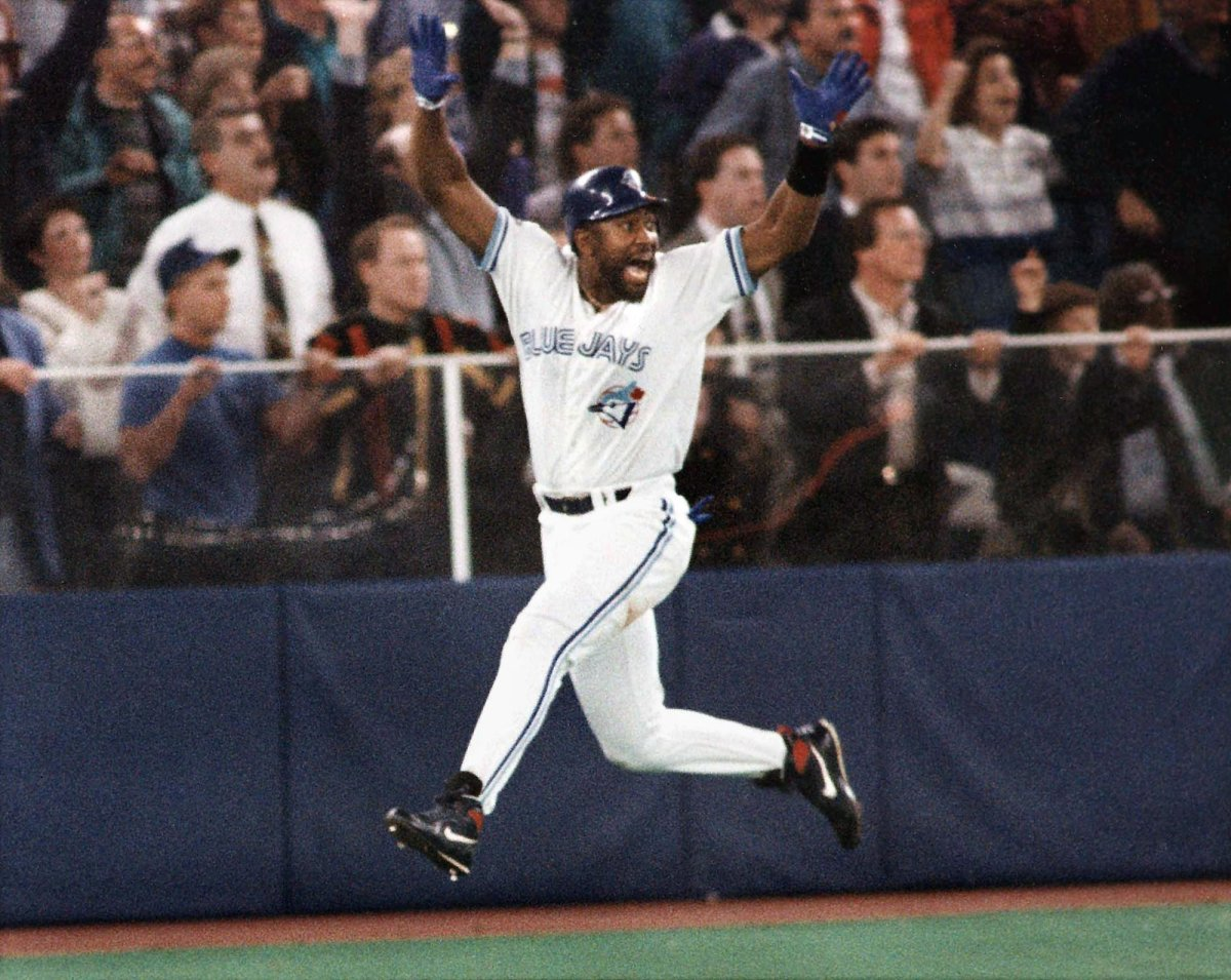 FILE - In this Oct. 23, 1993, file photo, Toronto Blue Jays' Joe Carter celebrates his game winning three-run home run in the ninth inning of Game 6 of the World Series against the Philadelphia Phillies in Toronto. (AP Photo/Mark Duncan, File).