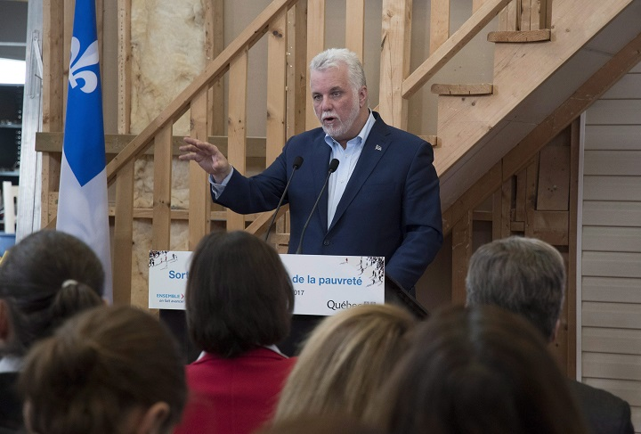 Quebec Premier Philippe Couillard speaks at a news conference, Sunday, December 10, 2017 at a physical rehab centre in Quebec City. Couillard announced a government plan to fight on poverty.