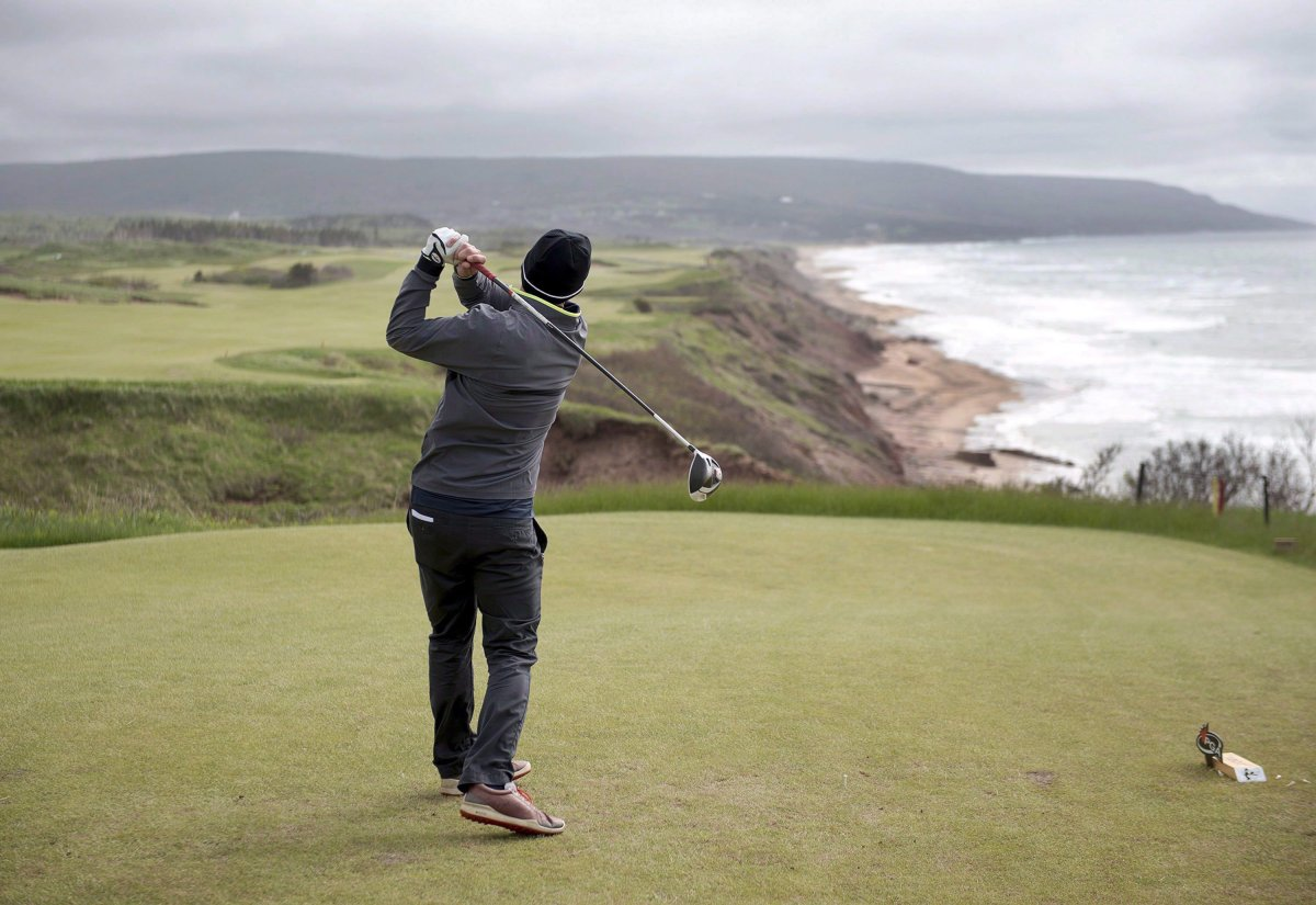 A golfer hits from the tee on the 528 yard, par 5, 18th hole at Cabot Cliffs in Inverness, N.S. on Wednesday, June 1, 2016.