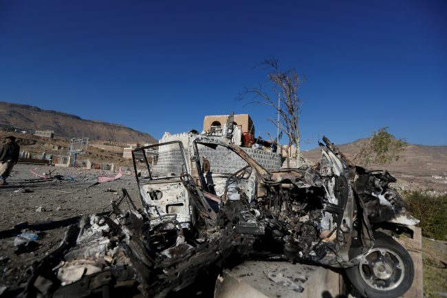 The wreckage of a vehicle is pictured at the site of air strikes in Sanaa, Yemen December 26, 2017.