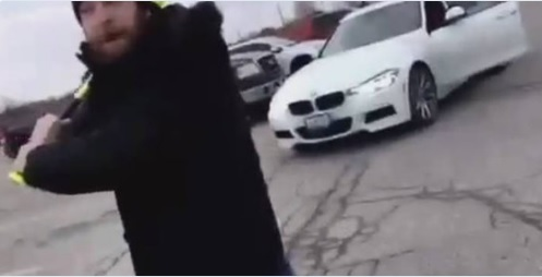 Mark Phillips is seen in a video swinging a baseball bat in a St. Thomas shopping mall parking lot.