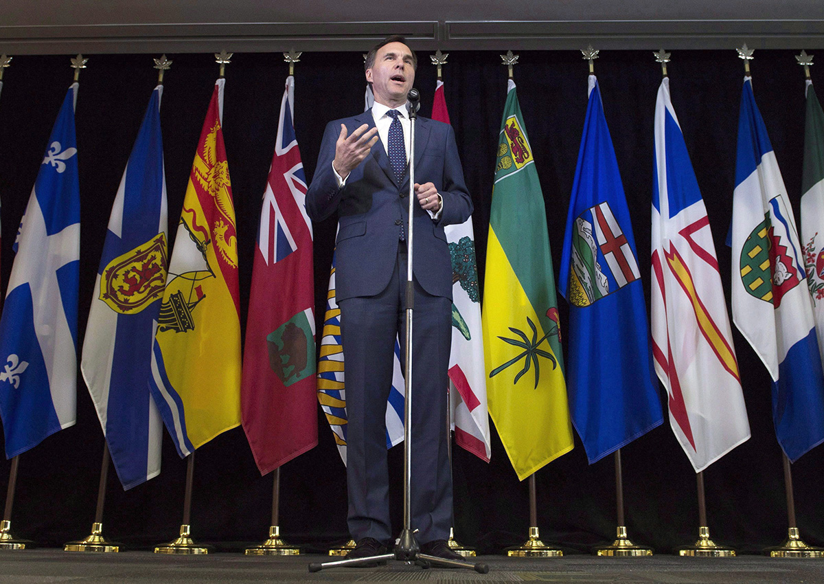 Finance Minister Bill Morneau speaks with the media following meetings with his provincial counterparts in Ottawa on June 19, 2017.