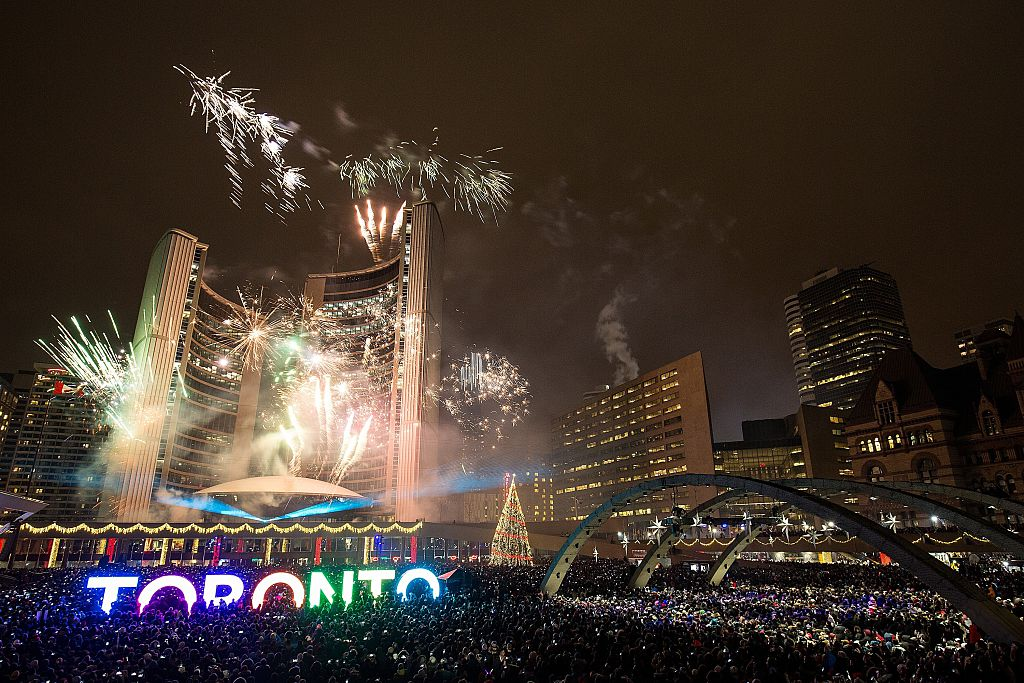 Fireworks light up the sky at Toronto's City Hall, Nathan Phillips Square, as the clock strikes midnight on January 1, 2016.