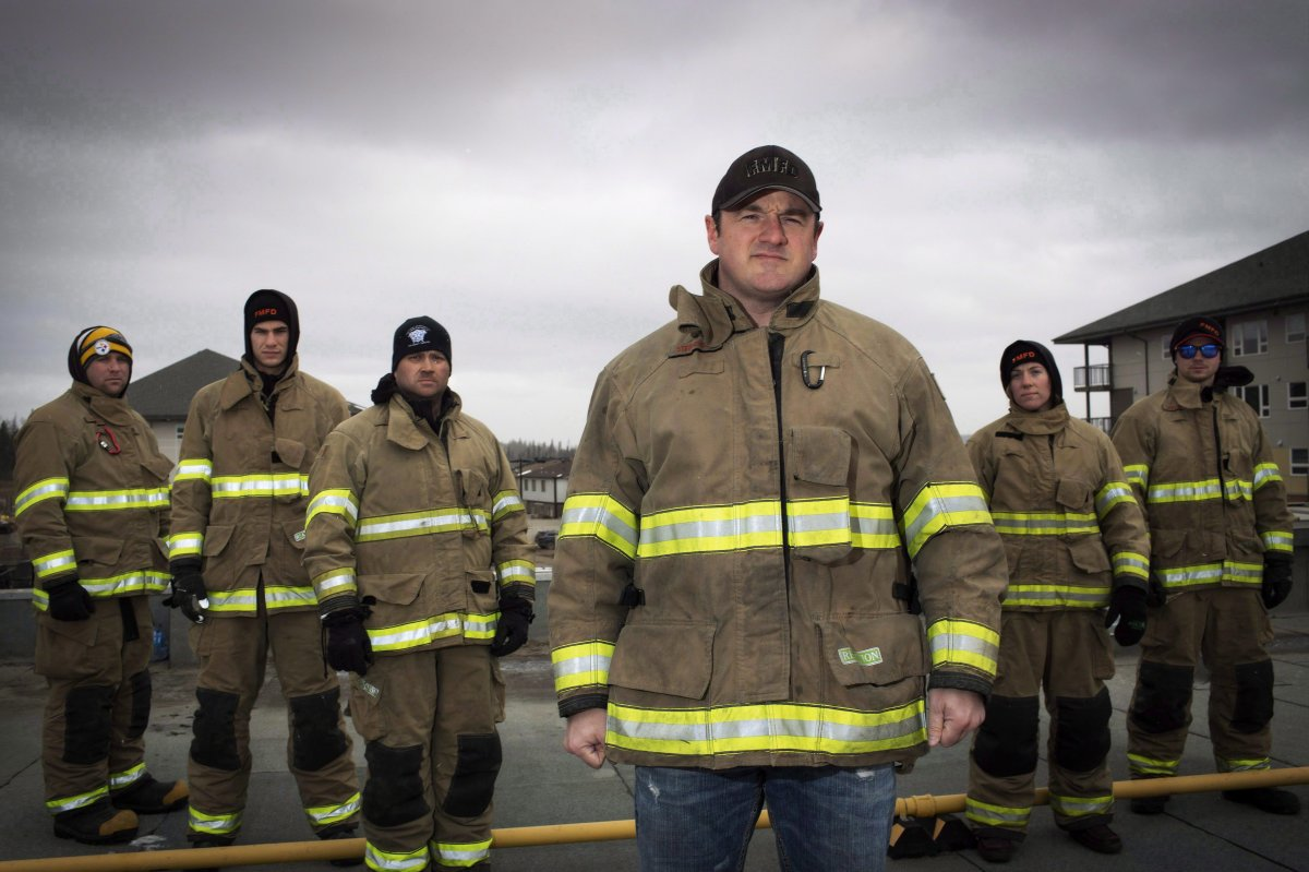 Firefighter Mark Stephenson (C) with fellow firefighters raising money at a charity event, filmed his house burning in the Abasand neighbourhood last year during the wildfires in Fort McMurray, Alta. Friday, April 22, 2017.