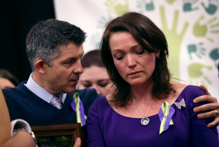 Ian Hockley and Nicole Hockley, parents of Sandy Hook massacre victim Dylan Hockley (6), embrace during a press conference with fellow parents of victims on the one month anniversary of the Newtown elementary school massacre on Jan. 14, 2013.