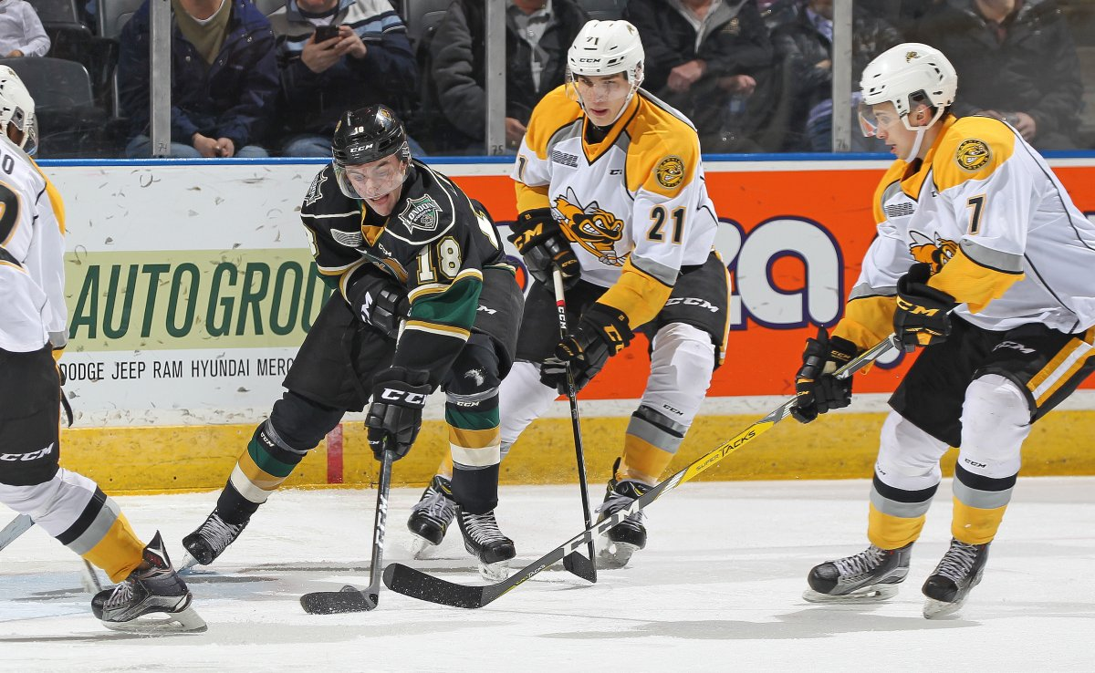 LONDON, ON - Liam Foudy #18 of the London Knights battles for a puck against Adam Ruzicka #21 of the Sarnia Sting during an OHL game at Budweiser Gardens in London, Ontario, Canada. (Photo by Claus Andersen/Getty Images).