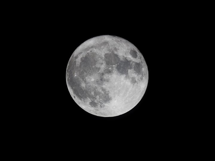 A Harvest Moon lit up the night's sky Monday, welcoming the seasonal change with the first full moon closest to autumnal equinox.