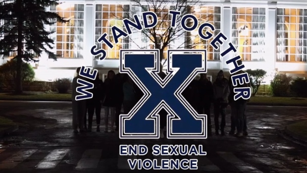 Some female athletes at St. Francis Xavier University have come up with a compelling response to sex charges against members of the varsity football team. A still image is shown from the campaign's video.
