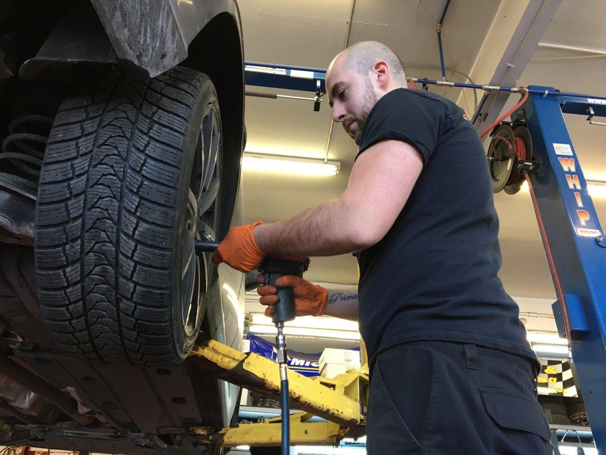John Massa installing winter tires at Garage Donati & Massa.