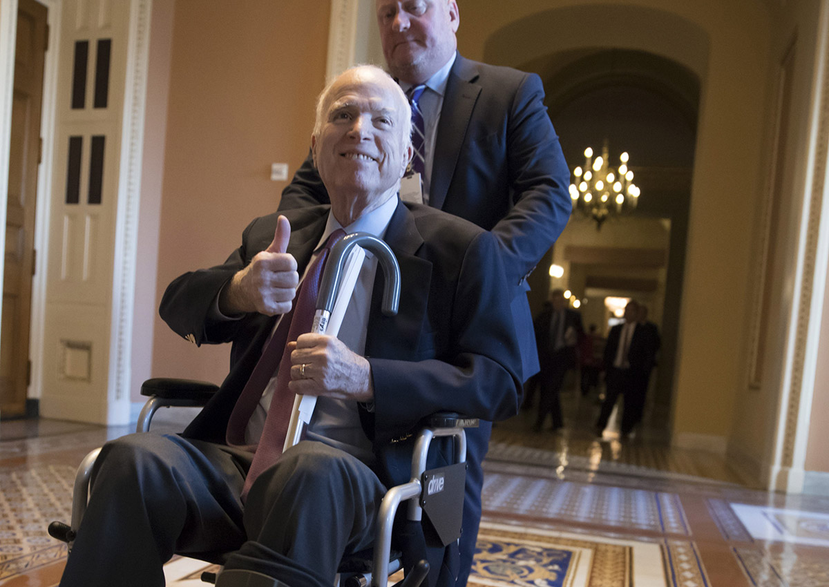In this Dec. 1, 2017 file photo, Sen. John McCain, R-Ariz., leaves a closed-door session where Republican senators met on the GOP effort to overhaul the tax code, on Capitol Hill in Washington.