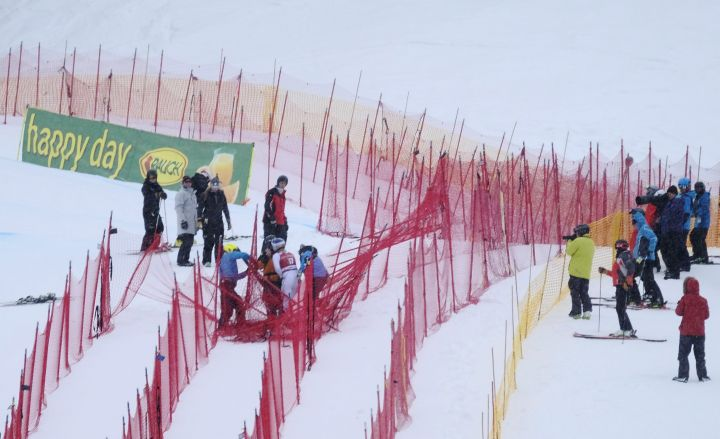 Lindsey Vonn of the USA is helped out of netting in the finish area following her run in the women's World Cup downhill ski race at Lake Louise, Alta., Friday, Dec. 1, 2017.