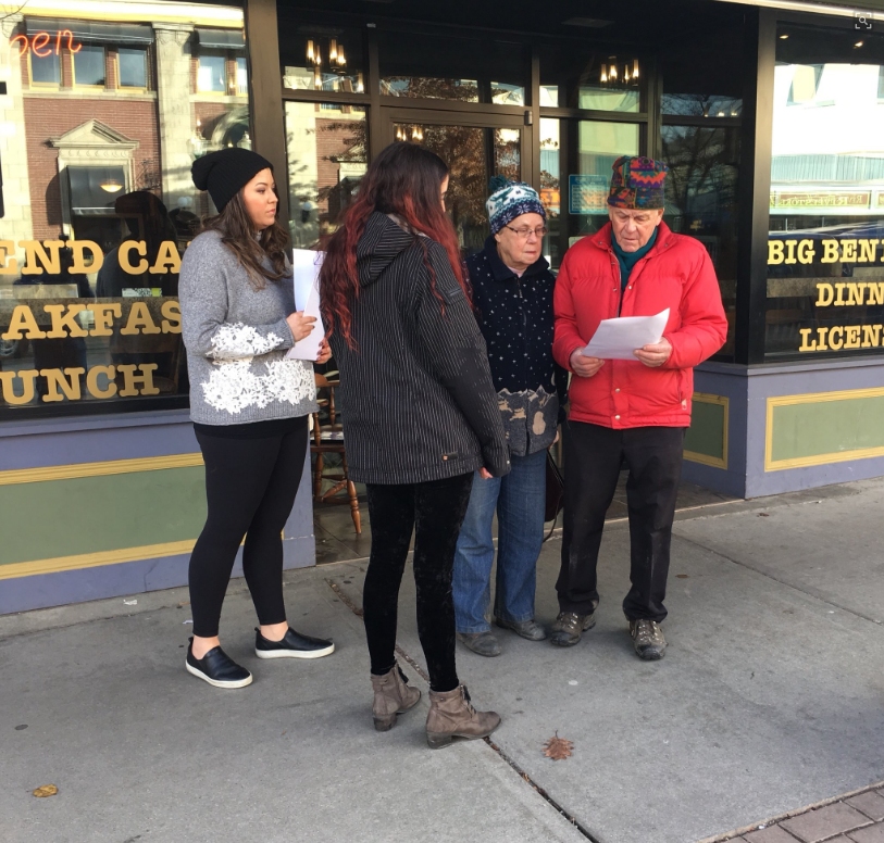 Family members of missing Alberta pilot Dominic Neron hand out missing persons flyers in Revelstoke.