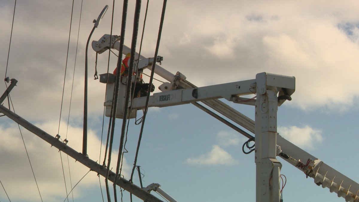 Nova Scotia Power crews work to repair the many power poles that snapped in half along Pleasant Street in Dartmouth.