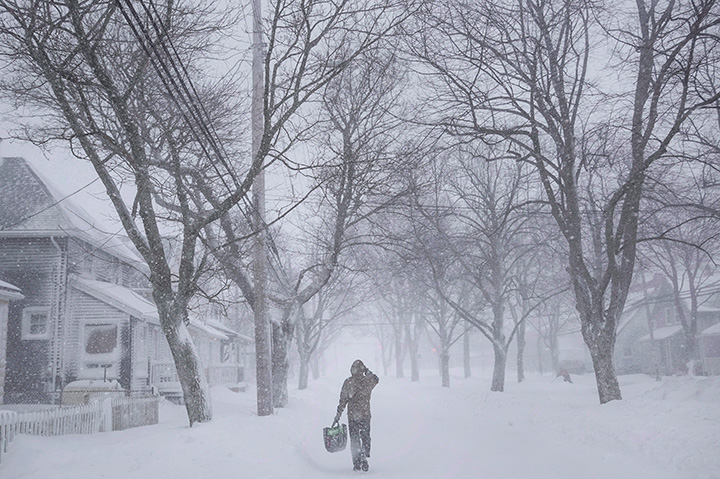 A man walks down the middle of Agricola Street in Halifax as a major winter storm blasts the Maritimes on Feb. 13, 2017.