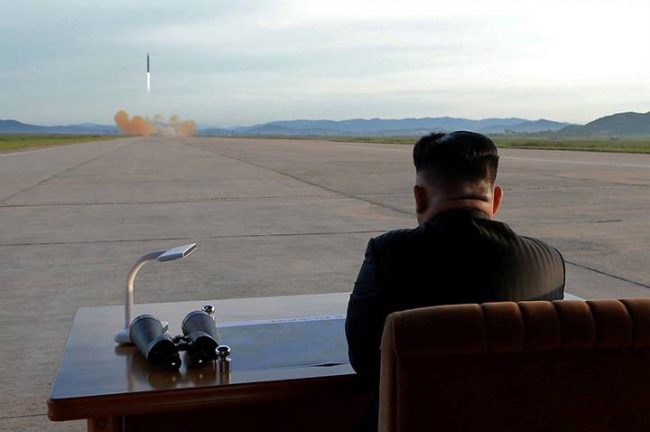 North Korean leader Kim Jong Un watches the launch of a Hwasong-12 missile in this undated photo released on Sept. 16, 2017.