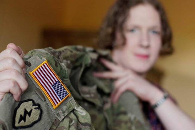 In this July 29, 2017 photo, transgender U.S. army captain Jennifer Sims lifts her uniform during an interview with The Associated Press in Beratzhausen near Regensburg, Germany.