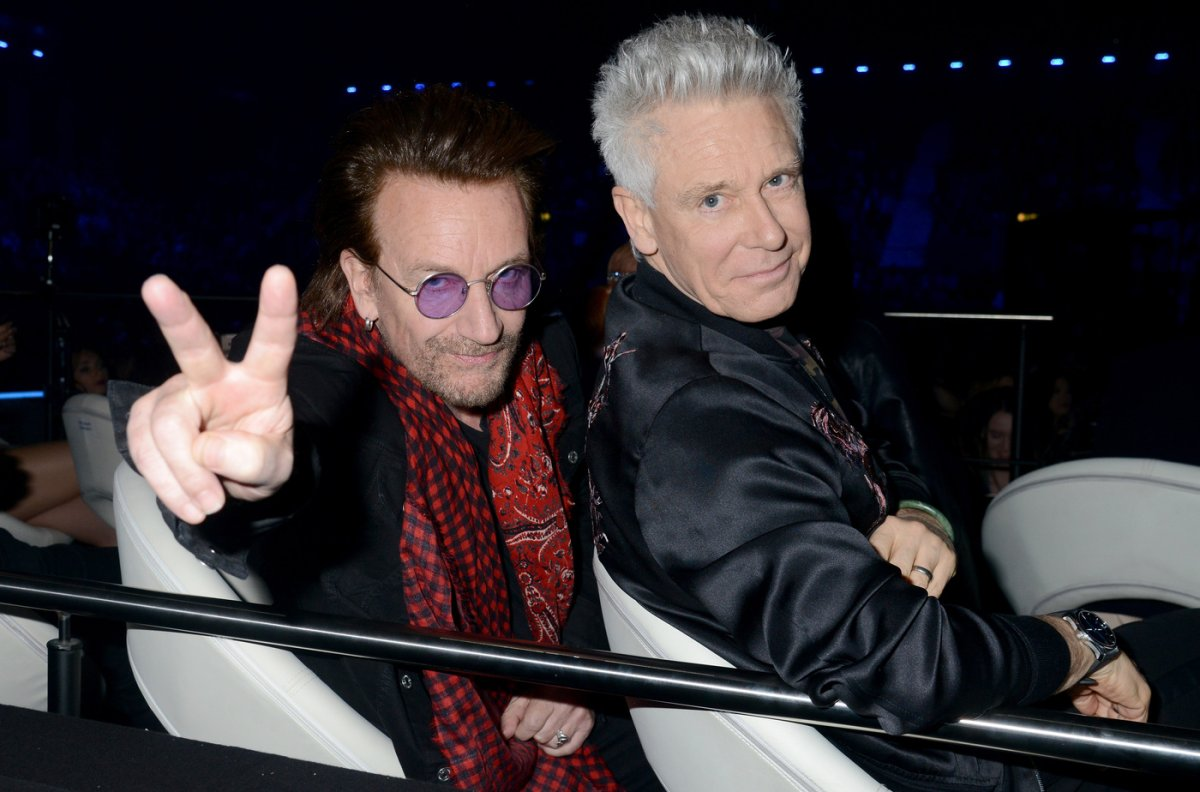 Bono (L) and Adam Clayton of U2 pose during the MTV EMAs held at The SSE Arena, Wembley on November 12, 2017.