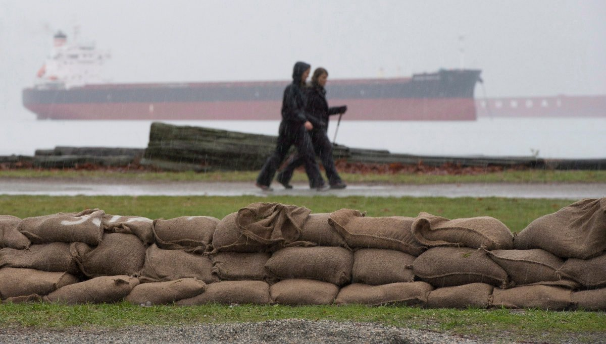 Sandbags are placed along the shores of Locarno Beach in Vancouver, Wednesday Dec. 10, 2014 in anticipation of a king tide.