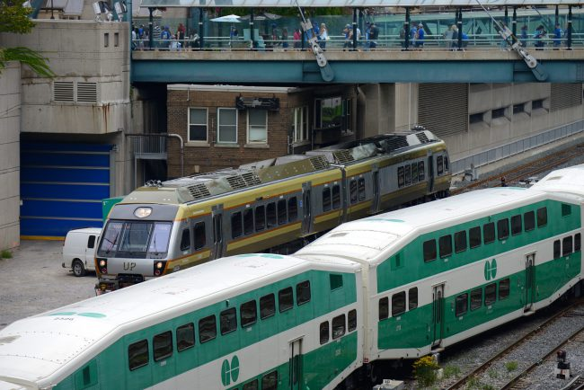 Two trains operated by Metrolinx, the Union Pearson Express and GO Transit pass at Union Station in Toronto, Ont., Aug. 29, 2015.