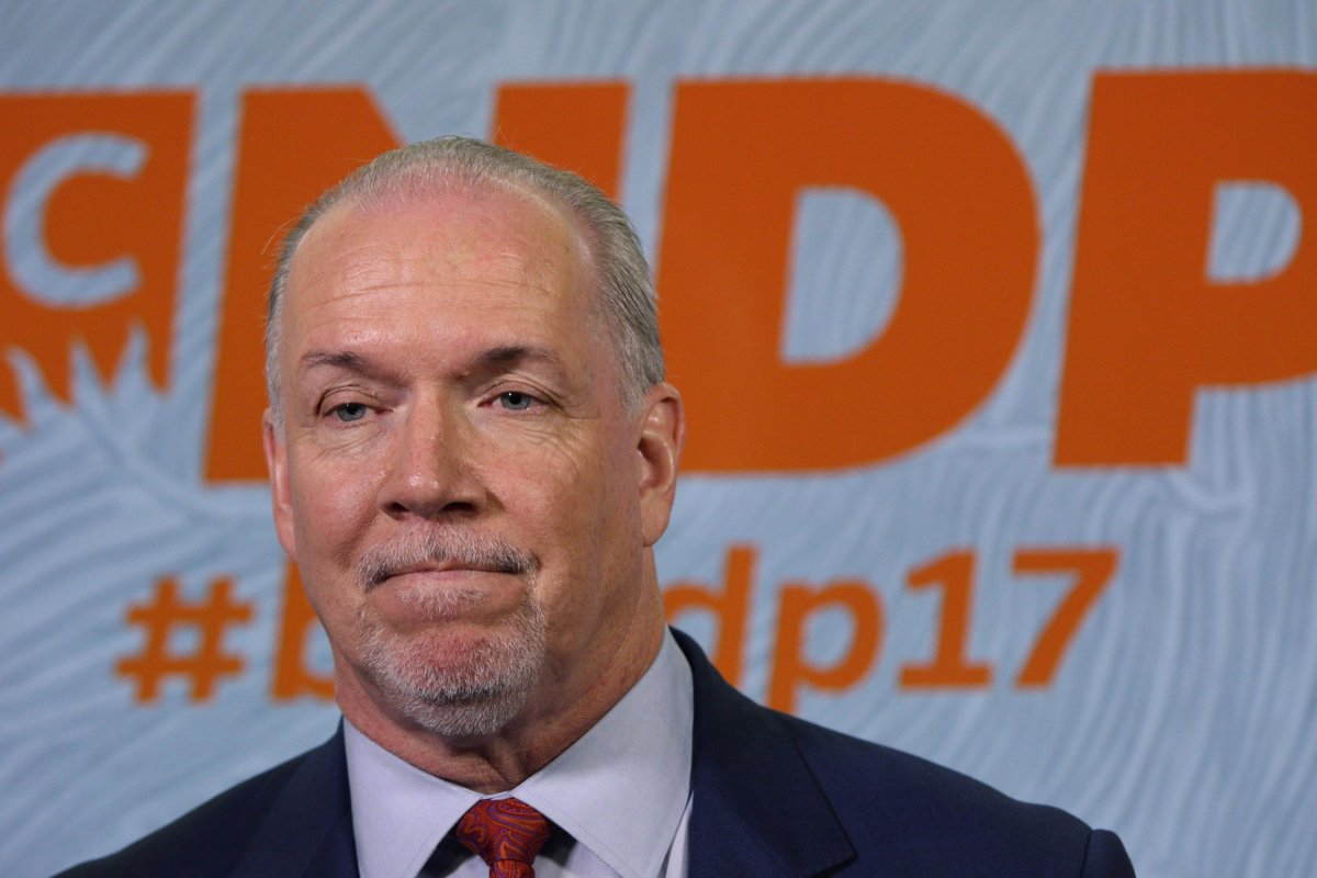 Premier John Horgan speaks to media following his speech to delegates and supporters during the B.C. NDP Convention at the Victoria Conference Centre in Victoria, B.C., on Saturday, November 4, 2017.