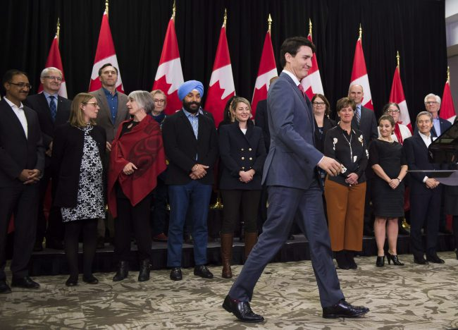 Prime Minister Justin Trudeau enters the room to address the media during his closing comments after attending the Liberal cabinet retreat in London, Ont., Jan. 12, 2018.