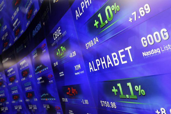 Electronic screens post prices of Alphabet stock at the Nasdaq MarketSite in New York, Feb. 1, 2016.