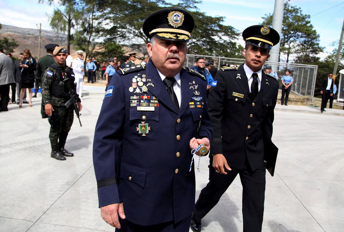 In this Jan. 15, 2018 photo, Honduras' new national Police Chief Jose David Aguilar Moran, center, leaves after a ceremony that transferred command to him in Tegucigalpa, Honduras.