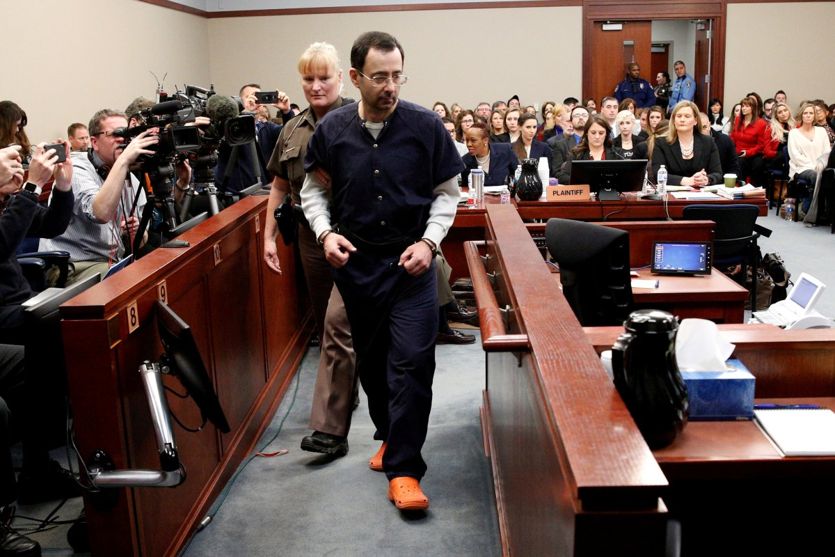Larry Nassar, a former team USA Gymnastics doctor who pleaded guilty in November 2017 to sexual assault charges, is escorted into the courtroom during his sentencing hearing in Lansing, Michigan, U.S., January 24, 2018.