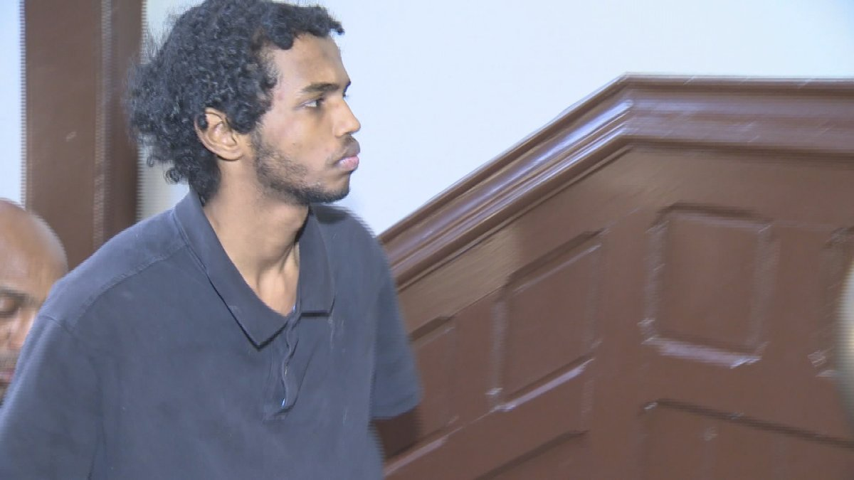 FILE- Abdoul Abdi appears in this file photo attending a Halifax Provincial Court hearing.