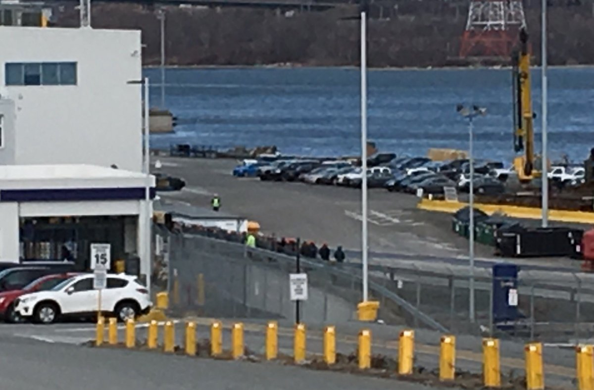 Workers at the Irving shipyard stand outside after walking off the job on Jan. 25, 2018.