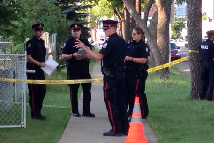 FILE: Edmonton police officers at a crime scene.