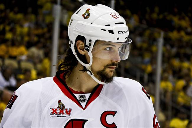 FILE - In this May 16, 2017, file photo, Ottawa Senators' Erik Karlsson prepares for a face-off during the second period of Game 2 of the Eastern Conference finals against the Pittsburgh Penguins, in Pittsburgh.