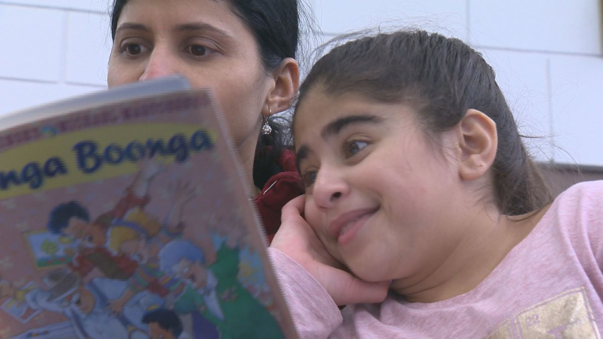 A mother and daughter bond over a book on Family Literacy Day.