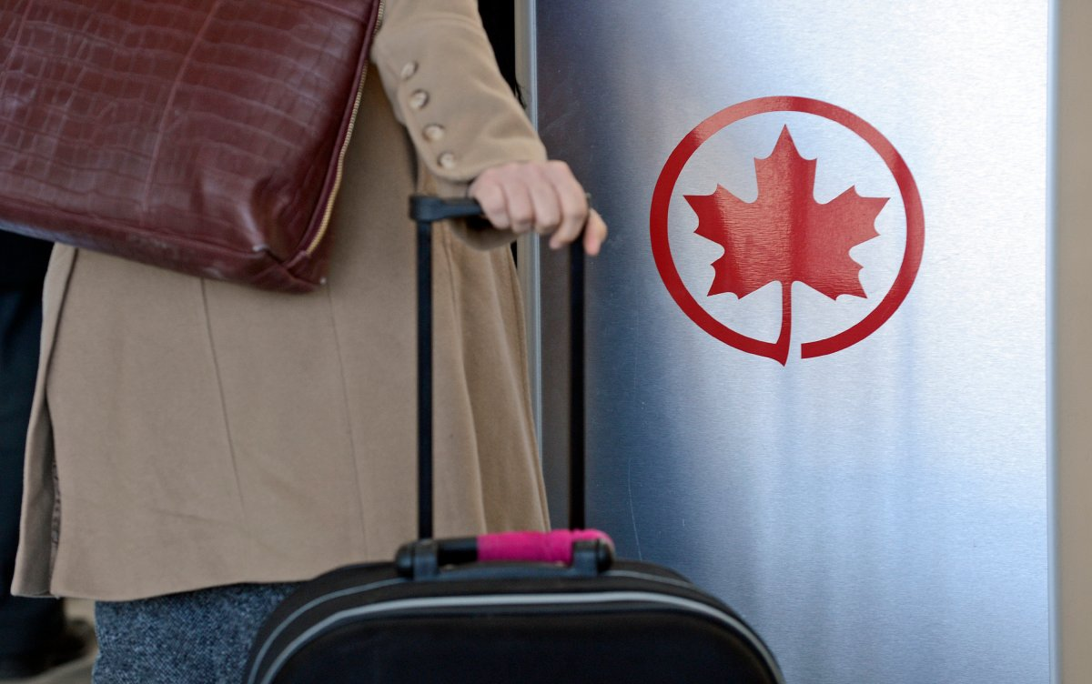 The Air Canada logo is seen next to a check-in area at Pearson International Airport in Toronto, Ontario, Canada, on Wednesday, Feb. 6, 2013.