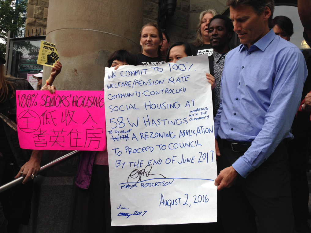 Vancouver Mayor Gregor Robertson meeting with housing activists about 58 W Hastings in 2016.