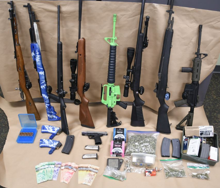 London police provided an image of the guns and drugs seized.