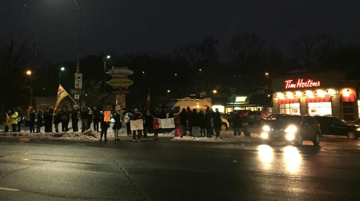 Dozens rallied in front of the Tim Hortons on York Road in Dundas on Wednesday.