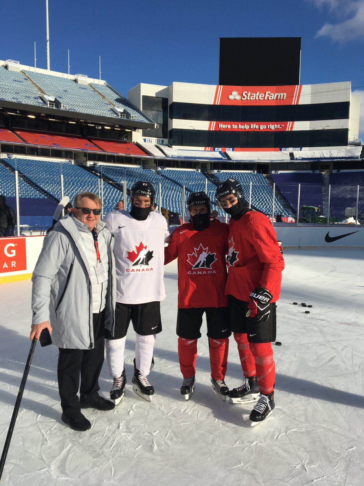 Buffalo, N.Y. Bob Martin, Robert Thomas, Victor Mete and Alex Formenton pose for a picture at New Era Stadium during the 2018 World Junior Hockey Championship.