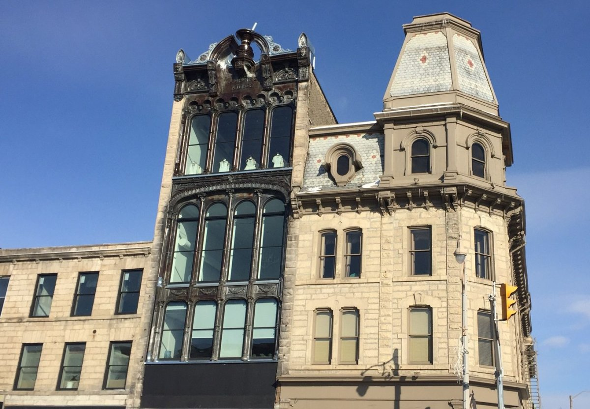 After an extensive restoration project, the facade of Guelph's Petrie Building was revealed this week.