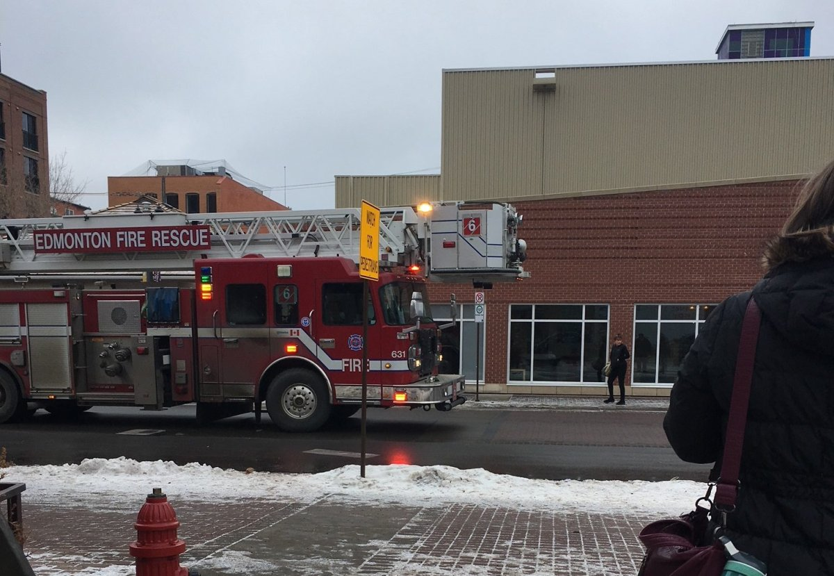 Fire crews are seen outside the Varscona Theatre in Old Strathcona after smoke was reported on Jan. 25, 2017.
