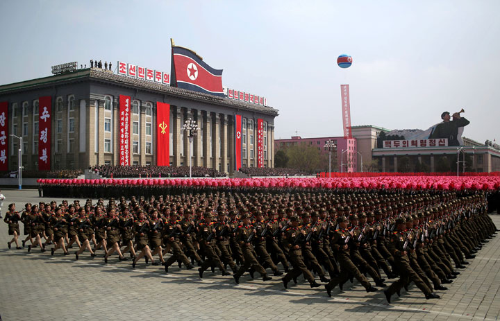 FILE - In this April 15, 2017, file photo, soldiers march across Kim Il Sung Square during a military parade in Pyongyang, North Korea. North Korea is preparing to stage a major event to mark the 70th anniversary of the founding of its military on Feb. 8, 2018 - just one day before the opening ceremony of the Pyeongchang Winter Olympics in South Korea.