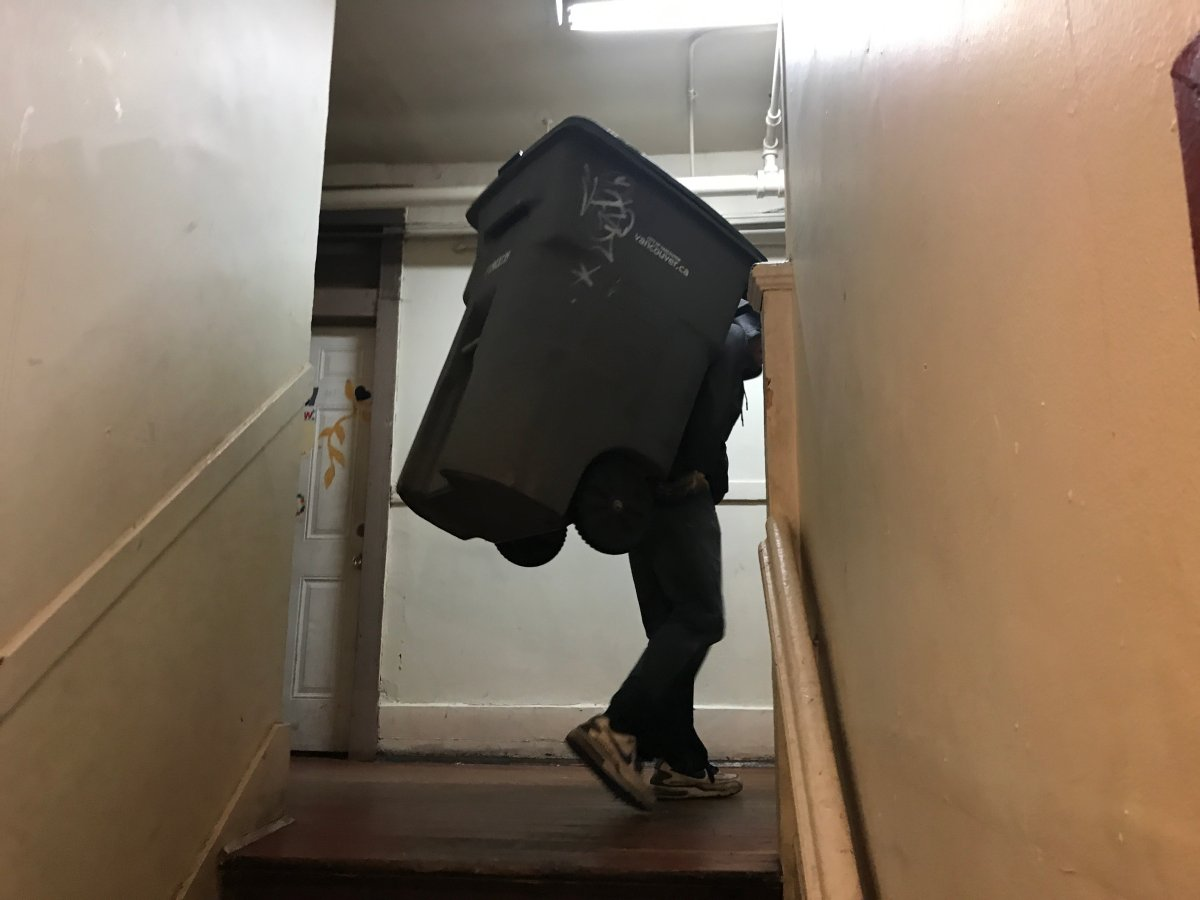 This SRO resident has to carry a large bin up several flights of stairs because the elevator hasn't worked for nearly two weeks.