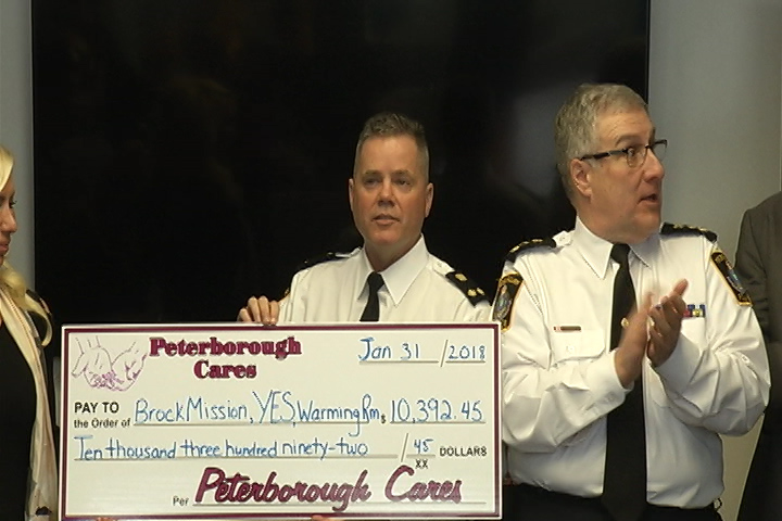 Deputy Peterborough policeChief Tim Farquharson handed the Brock Mission, the Youth Emergency Shelter and the Warming Room just under $3,500 cash on Wednesday at the Water Street police station.
