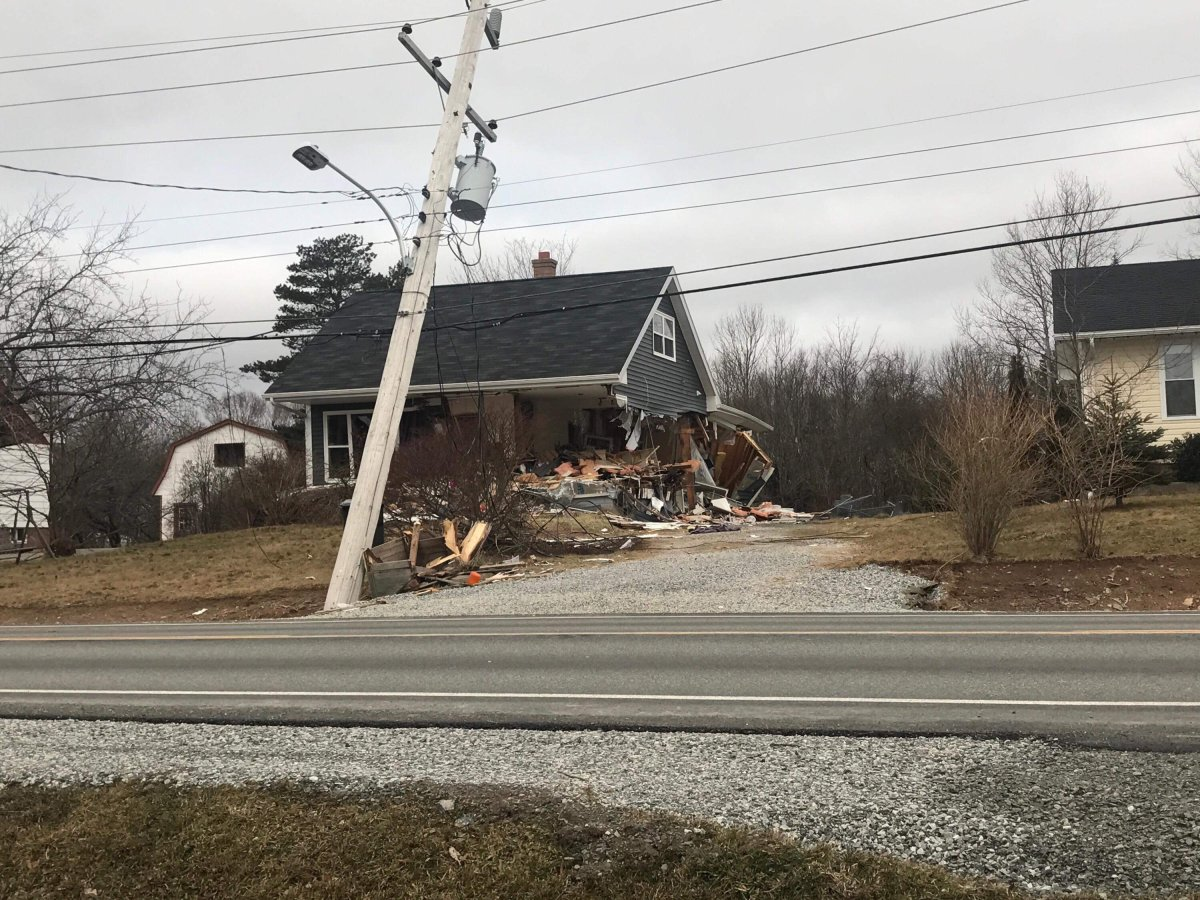 Police say the driver of the loader and owner of the damaged home are known to each other.