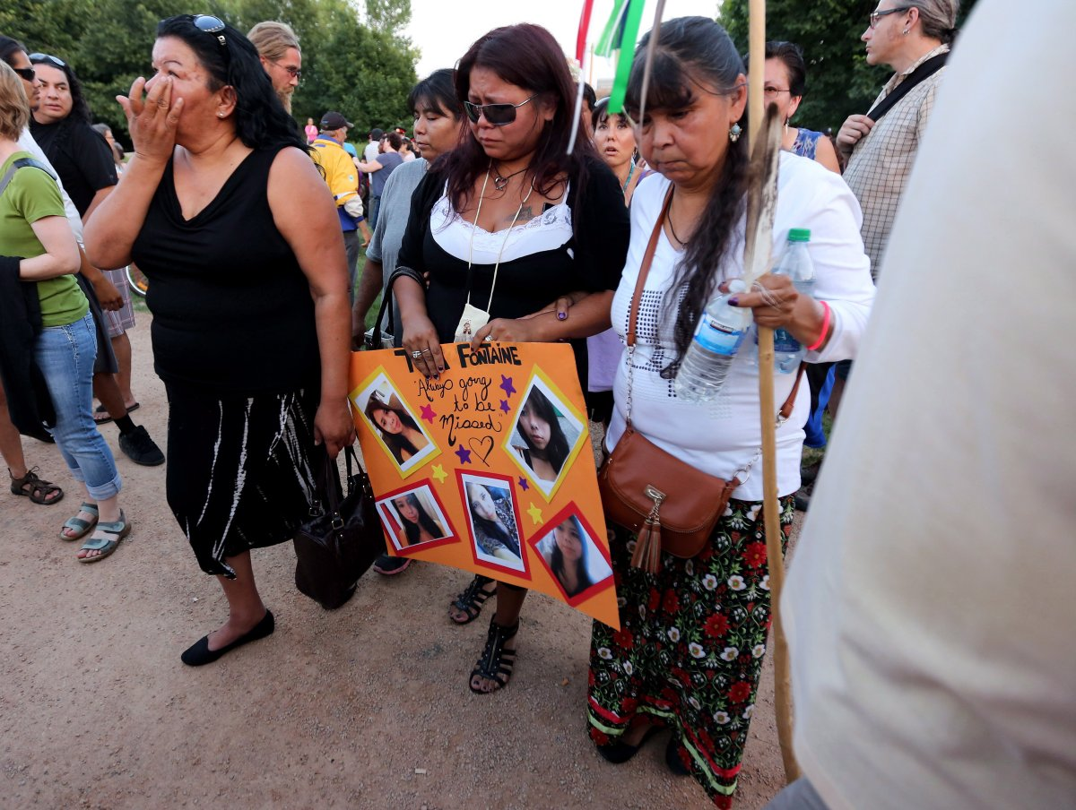 Tina Fontaine, centre, attends a vigil for her daughter Tina Fontaine and Faron Hall at the Oodena Circle at The Forks in Winnipeg, Manitoba, Tuesday, August 19, 2014.