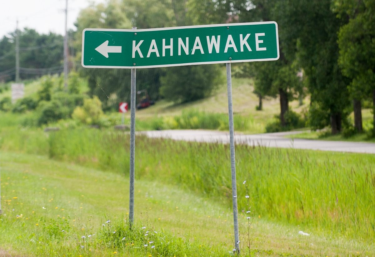 A sign for the Kahnawake Mohawk reserve where plans to reopen amid the COVID-19 pandemic have been put on pause. Tuesday, Aug. 4, 2020.