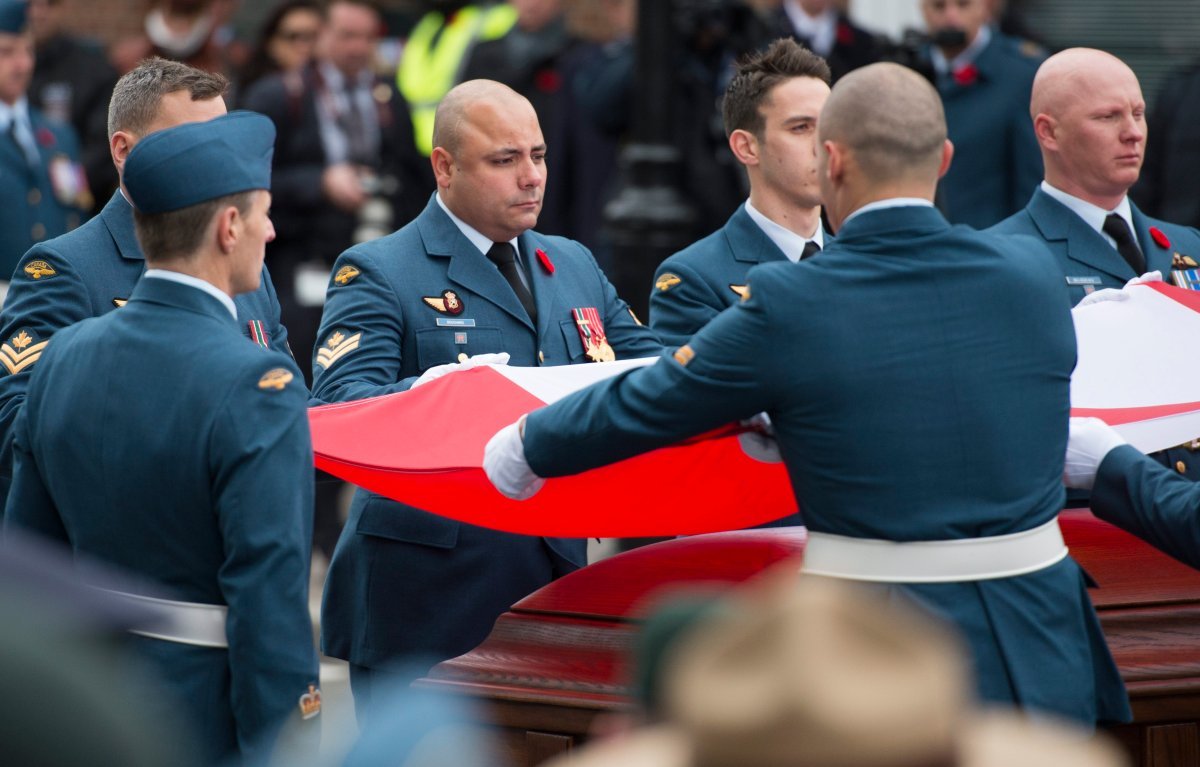 """The funeral of Warrant Officer Patrice Vincent, killed in an October 2014 terrorist attack in Quebec. On social media, Othman Hamdan allegedly called Vincent's killer a """"hero."""" THE CANADIAN PRESS IMAGES/Graham Hughes."""
